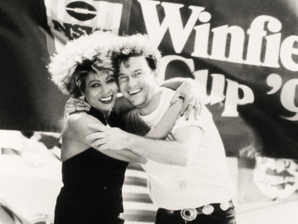 Tina Turner and Jimmy Barnes at the 1993 Grand Final. Picture: Action Photographics