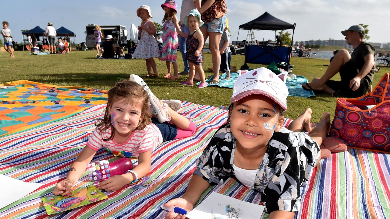 Dusk is a free, family friendly outdoor community event held at Venue 114 (formerly known as Lake Kawana Community Centre). Aisha Costoulas and Maita Dawkins soak up the atmosphere at a previous event. Picture: Warren Lynam