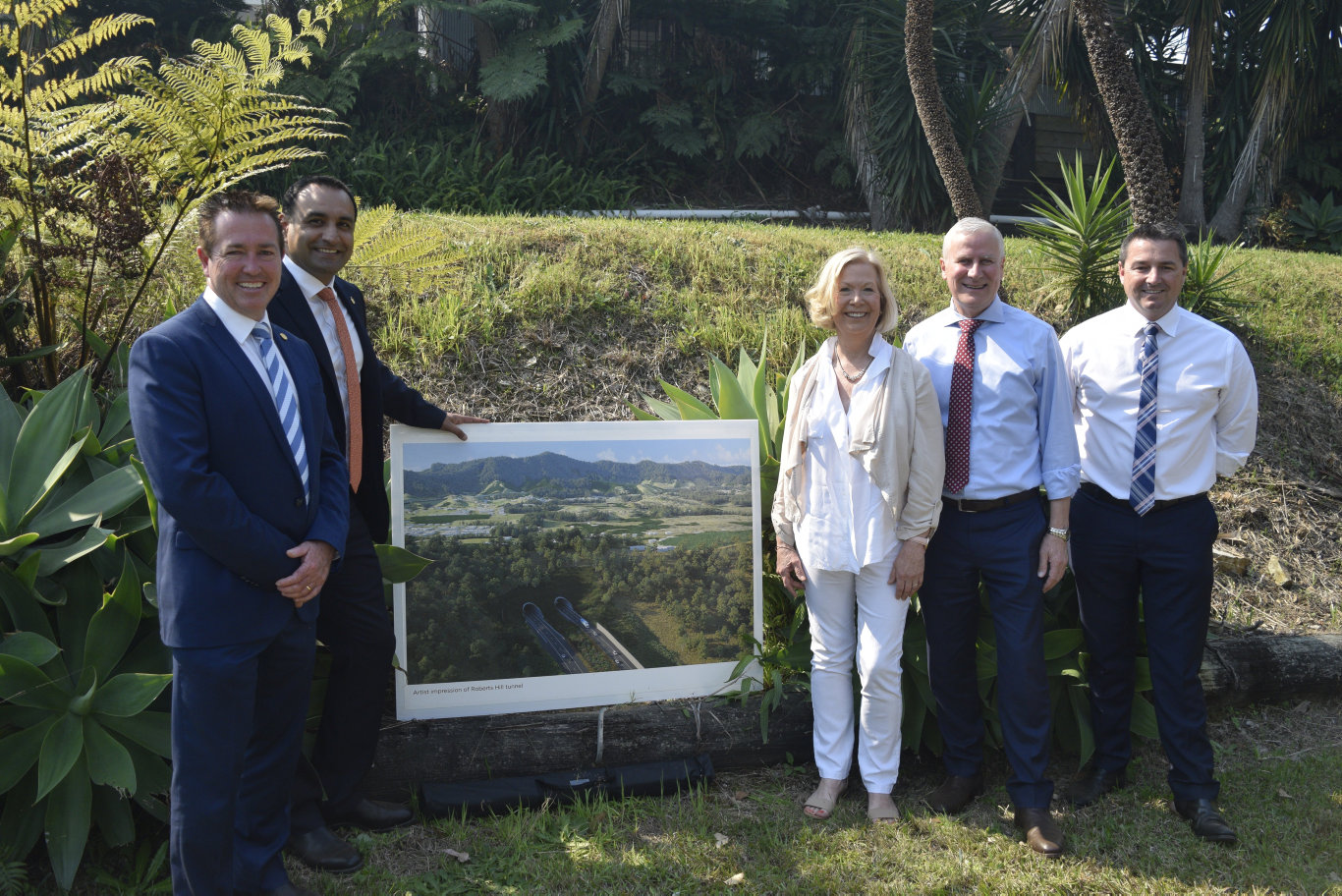 Paul Toole, Gurmesh Singh, Denise Kinight, Michael McCormack and Pat Conaghan with an image of the proposed bypass.