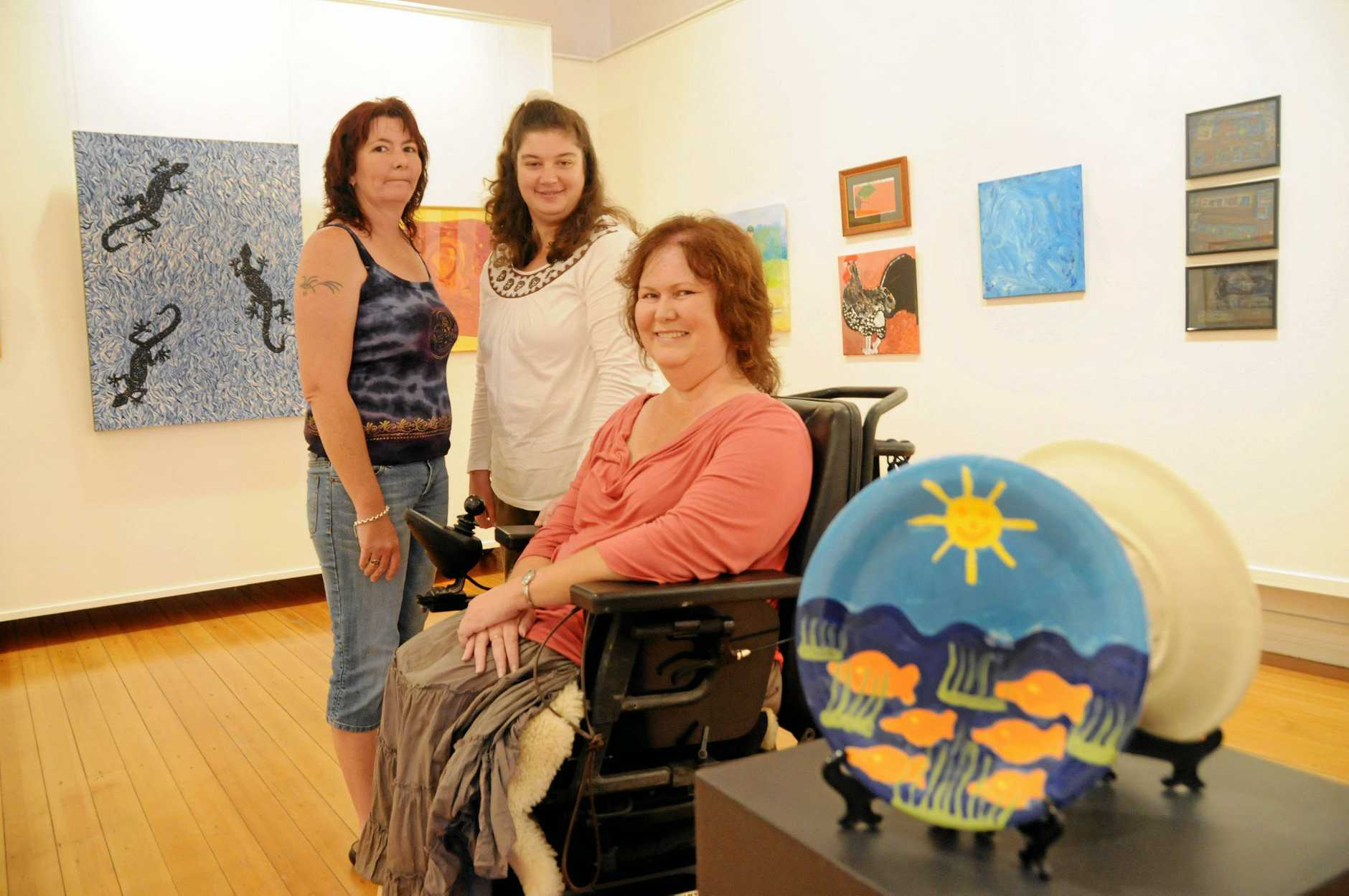 Natalie Ellis with Erin Neilson and Roxanne McGregor in the art gallery for Disability Action Week.