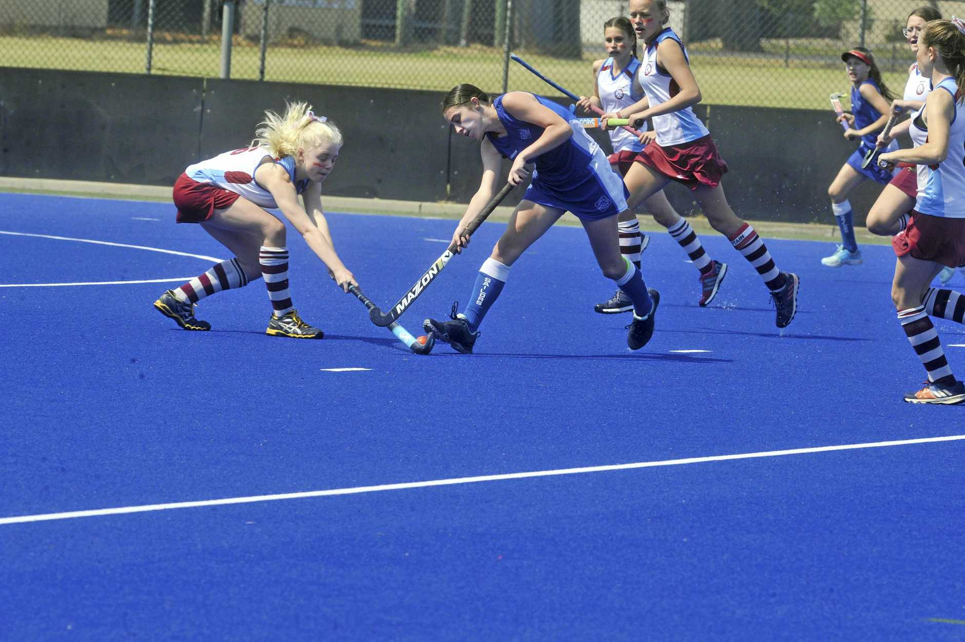 STRONG DEFENCE: MccAuley Comets star Kaydence Kilduff lays a tackle on Sailors ESPresso in the grand final.