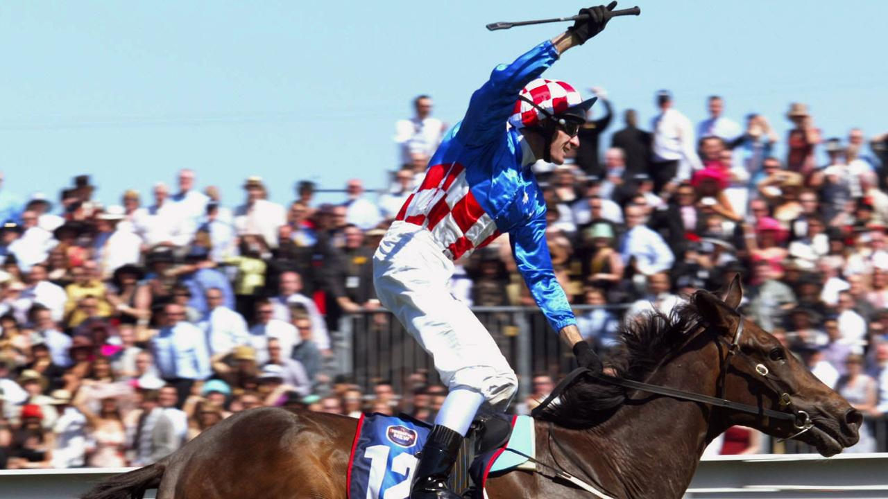 Glen Boss salutes on Makybe Diva in the 2003 Melbourne Cup.