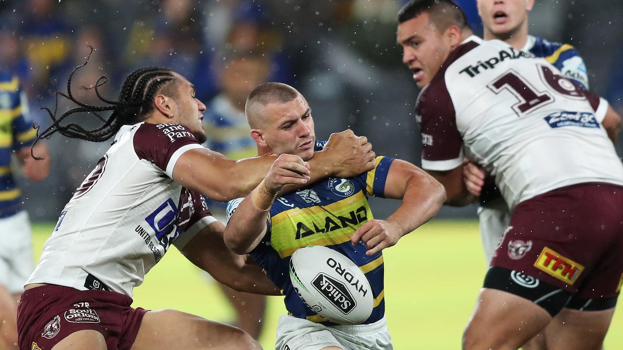 Manly's Martin Taupau hits Parramatta's Raymond Stone high.