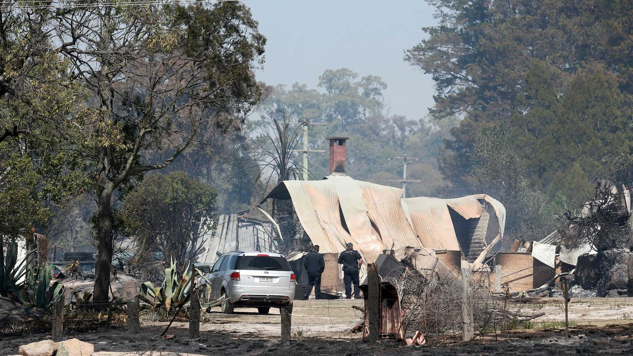 Police survey the damage on Caves Rd, Stanthorpe. Picture: AAP/Image Sarah Marshall
