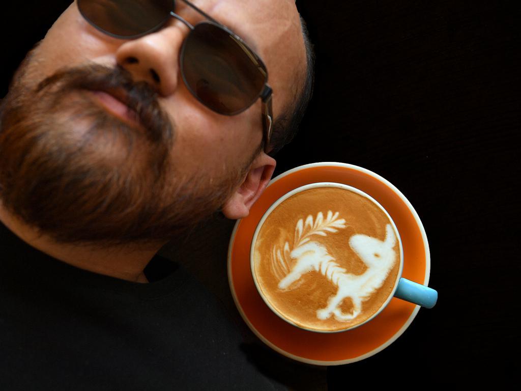 Johnie Stark of Pallet Espresso Bar in Mooloolaba creating coffee designs. Photo: John McCutcheon / Sunshine Coast Daily