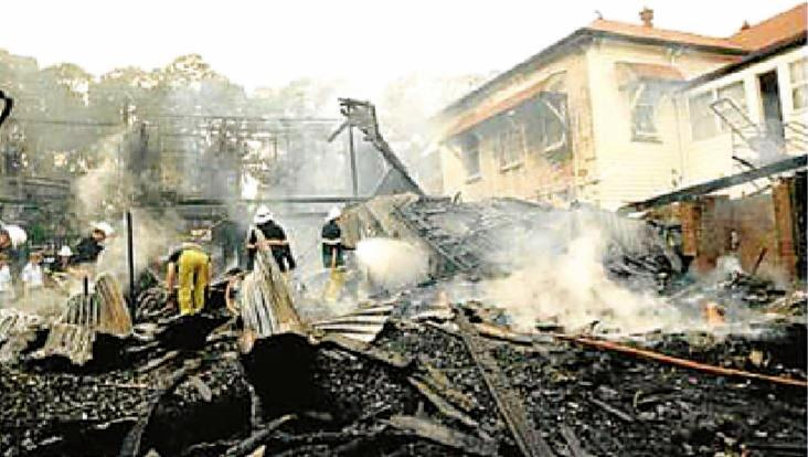 SAD SCENE: The smouldering aftermath of the Oakdale Guest House fire in 1990.