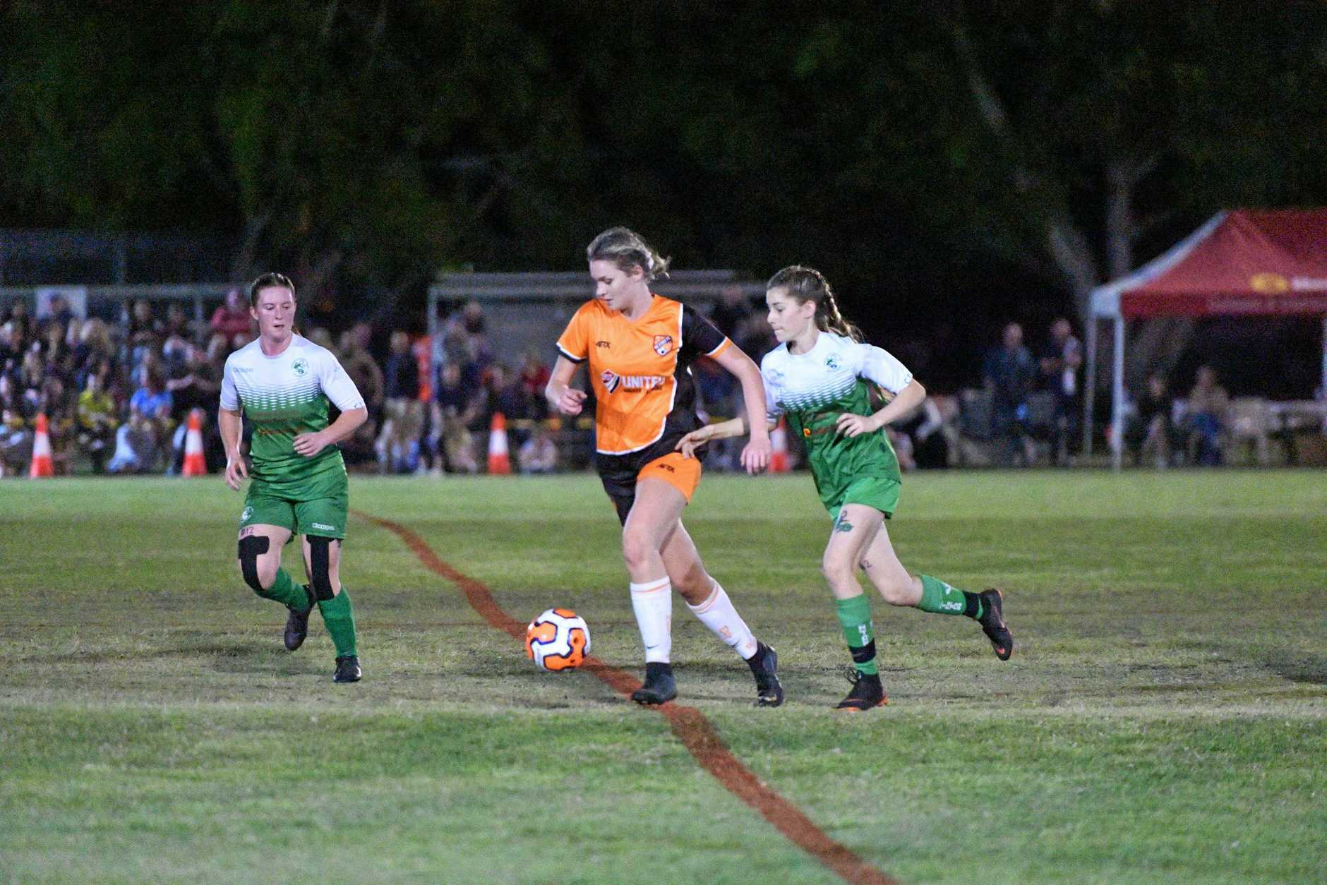 Meteors Josephine Ware and Clinton's Chantelle Sharp in the Div. 1 women's soccer grand final