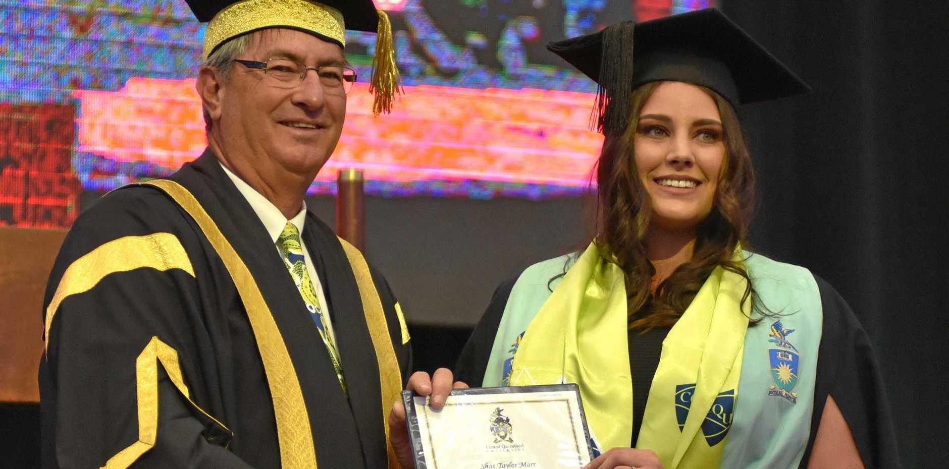 PROUD RESULT: CQUniversity Chancellor John Abbott with graduate Shae Marr.