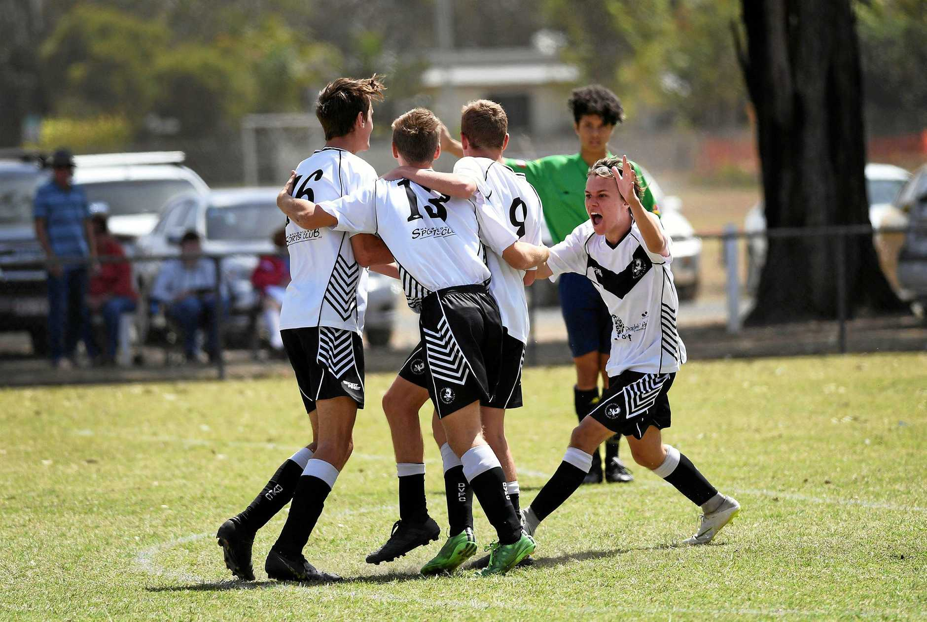 CHAMPIONS: Doon Villa players celebrate what proved to be the winning goal of Saturday's grand final.