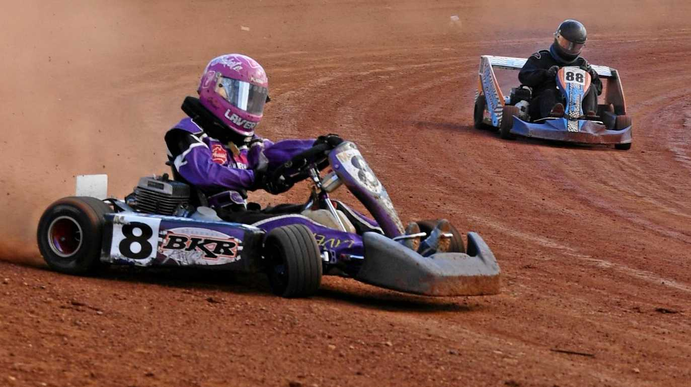 QUEEN OF THE TRACK: Dakota Laverty slides her kart in front of Kyle Price on the Maryborough circuit earlier this season