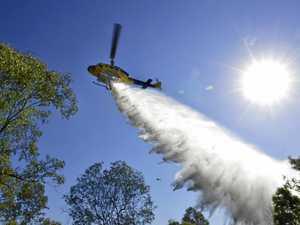 AVOID THE AREA: Water bombing, fireys battle blaze