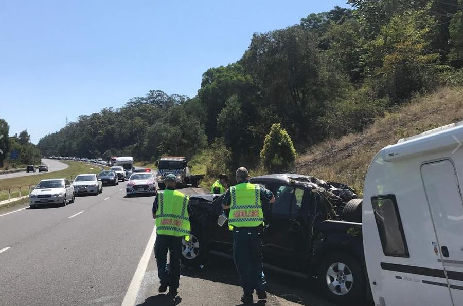 A car tolling a caravan rolled on the Bruce Highway at Cooroy. Image: Clayton's Towing.