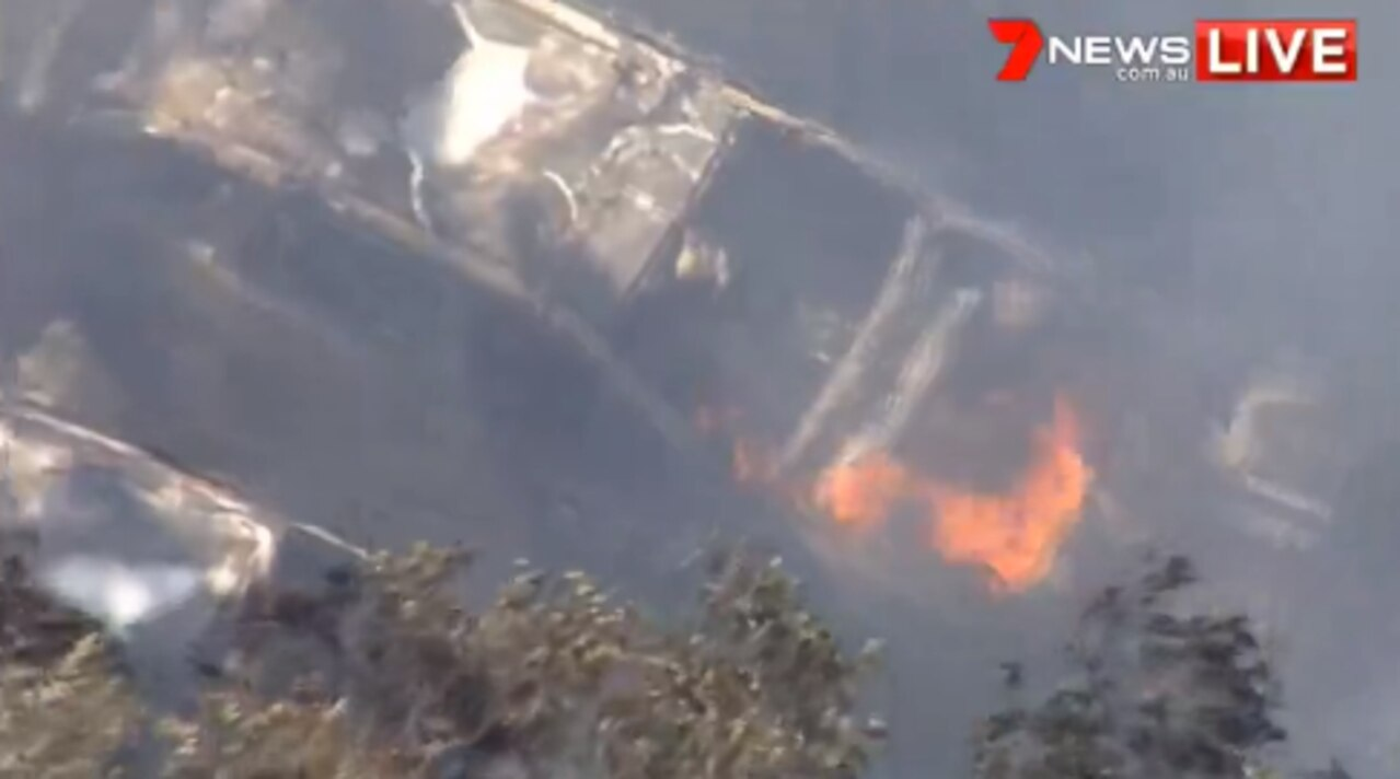 Fire crews are working to contain a factory fire on Brisbane's northside. Picture: 7 News