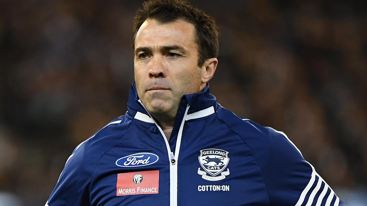 Geelong Cats head coach Chris Scott runs from the field during the AFL first qualifying final match.