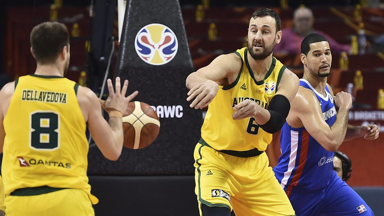 Andrew Bogut of Australia, right, passes to teammate Matthew Dellavedova during their victory over the Dominican Republic. Picture: AP Photo
