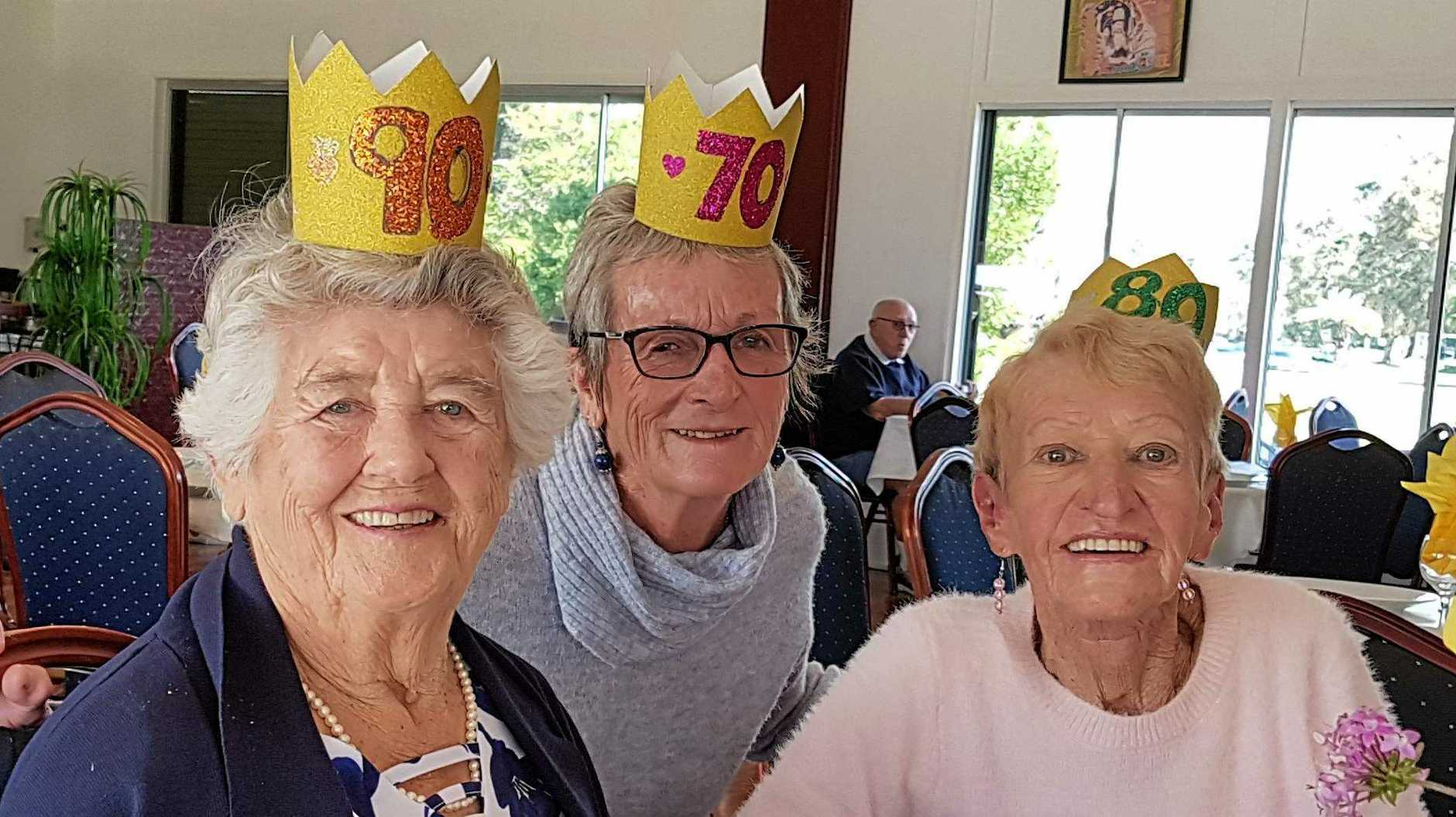 A TRIPLE TOAST: Edna Harrison, 90, Ros Gilligan, 70 and Trish Holgate, 80, celebrated with 30 Coolangatta Bowls members and friends, at the club's Feng Shui restaurant.
