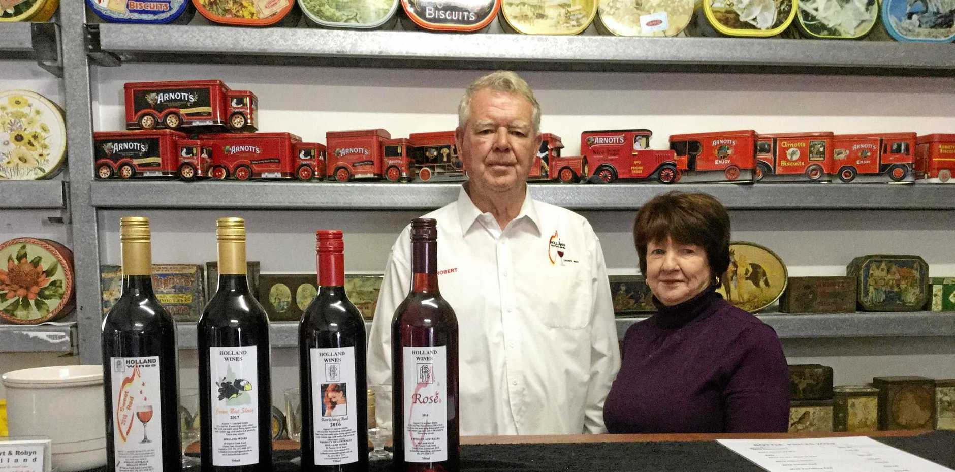 NEW CAREER: Bob and Robyn Holland's Crows Nest winery, started after retirement, offers both wine tastings and the largest collection of Arnott's biscuit tins on public view.