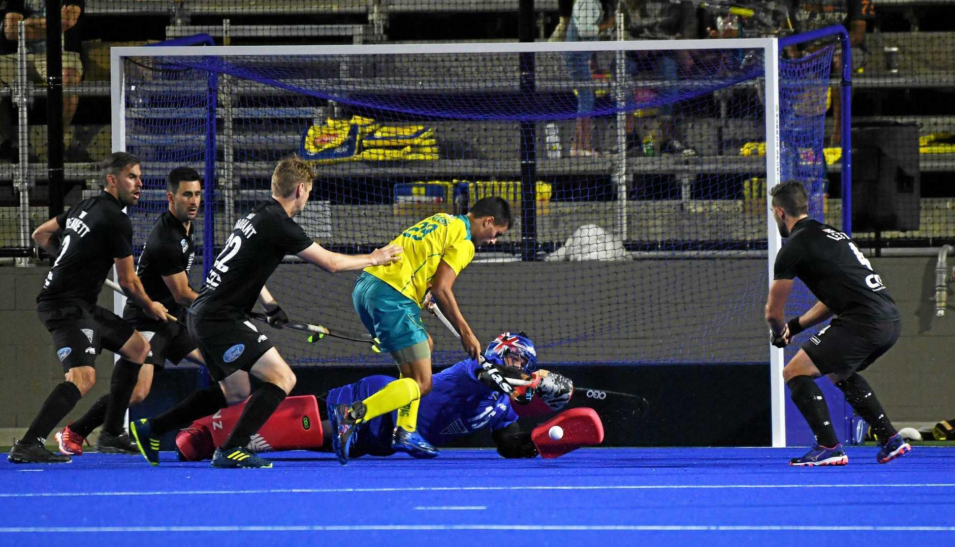 Hockey: Australia's Tim Brand and New Zealand's GK George Enersen.