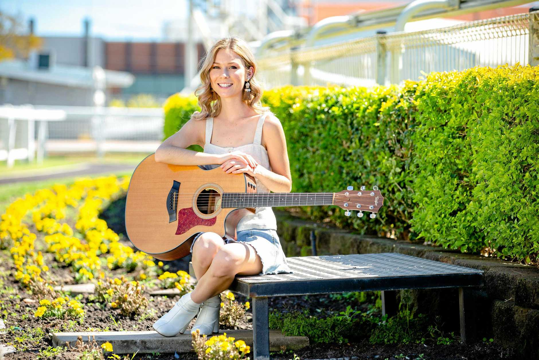 BACK IN THE SADDLE: Caitlyn Shadbolt poses for a photograph at Doomben Racecourse to promote Country Music Raceday.
