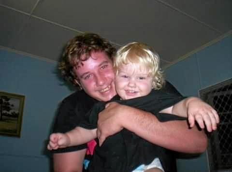 Tylor Bell nursing one of his five children.