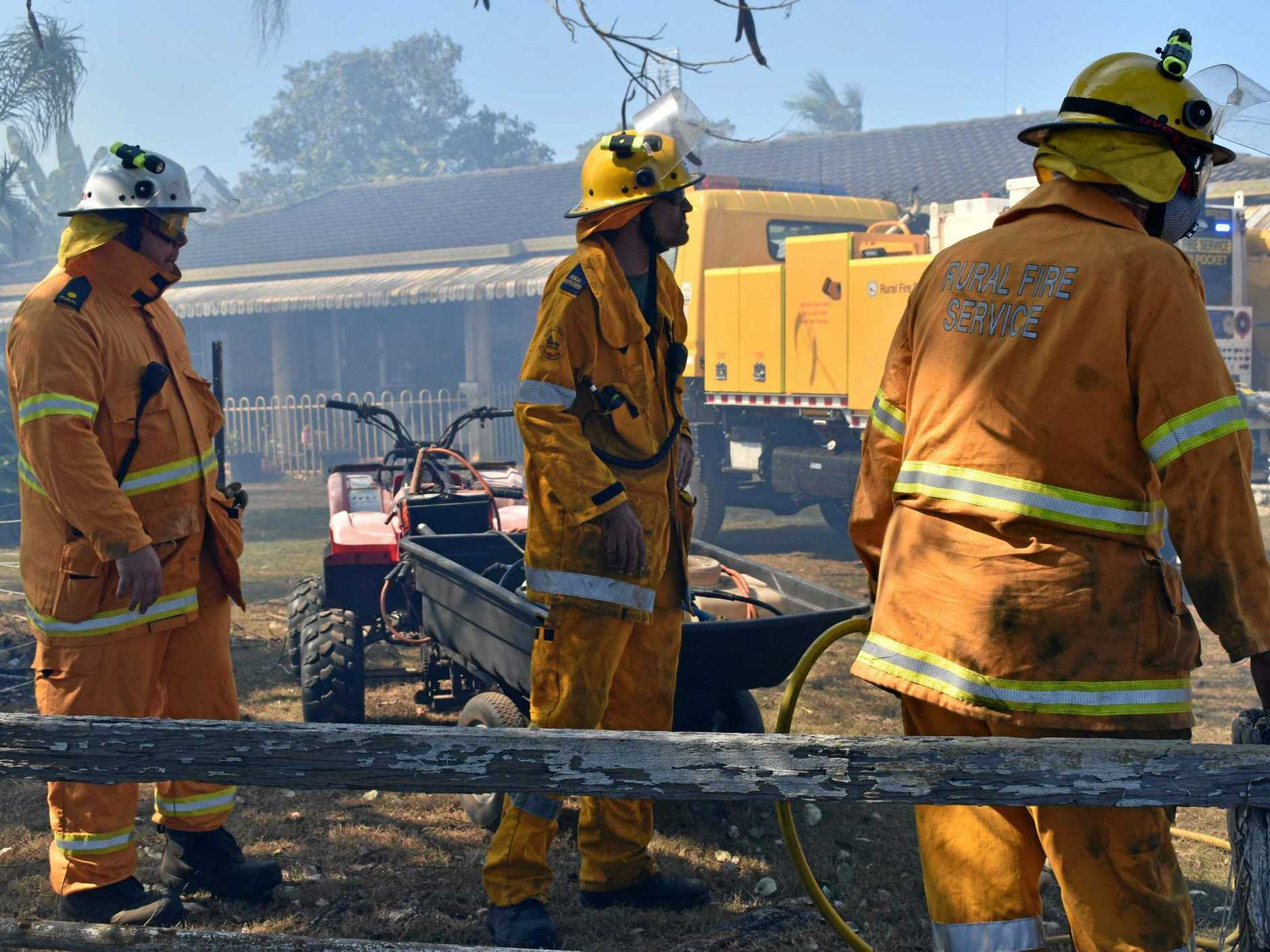 Firefighters work to contain the blaze at Tamaree.