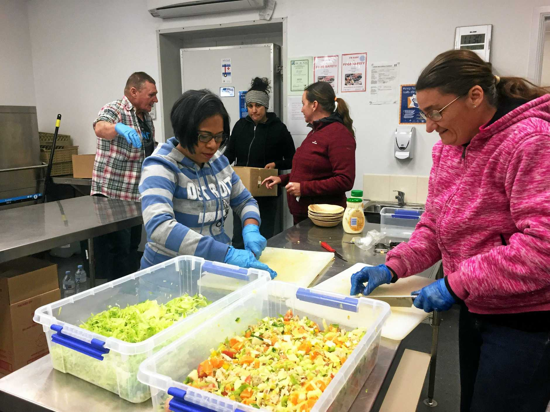 HELPING HAND: Chia Eastly and Rachel Ellis prepare meals for emergency crews and displaced residents.