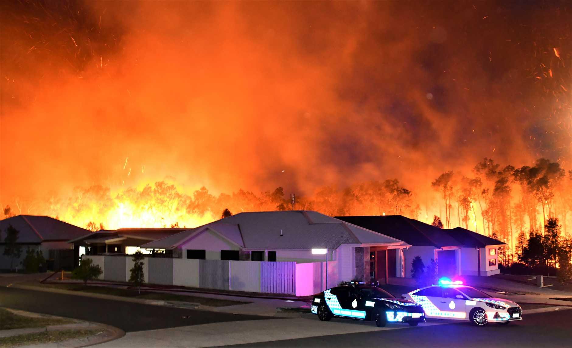 A bushfire burns close to Peregian homes.