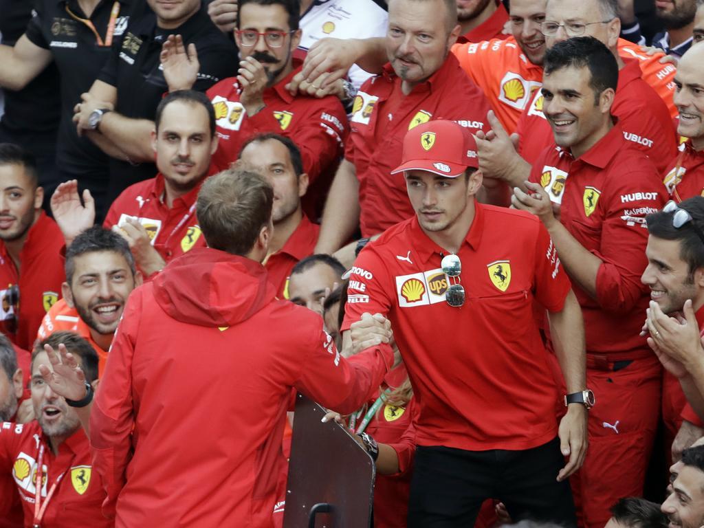 Sebastian Vettel congratulates Charles Leclerc.