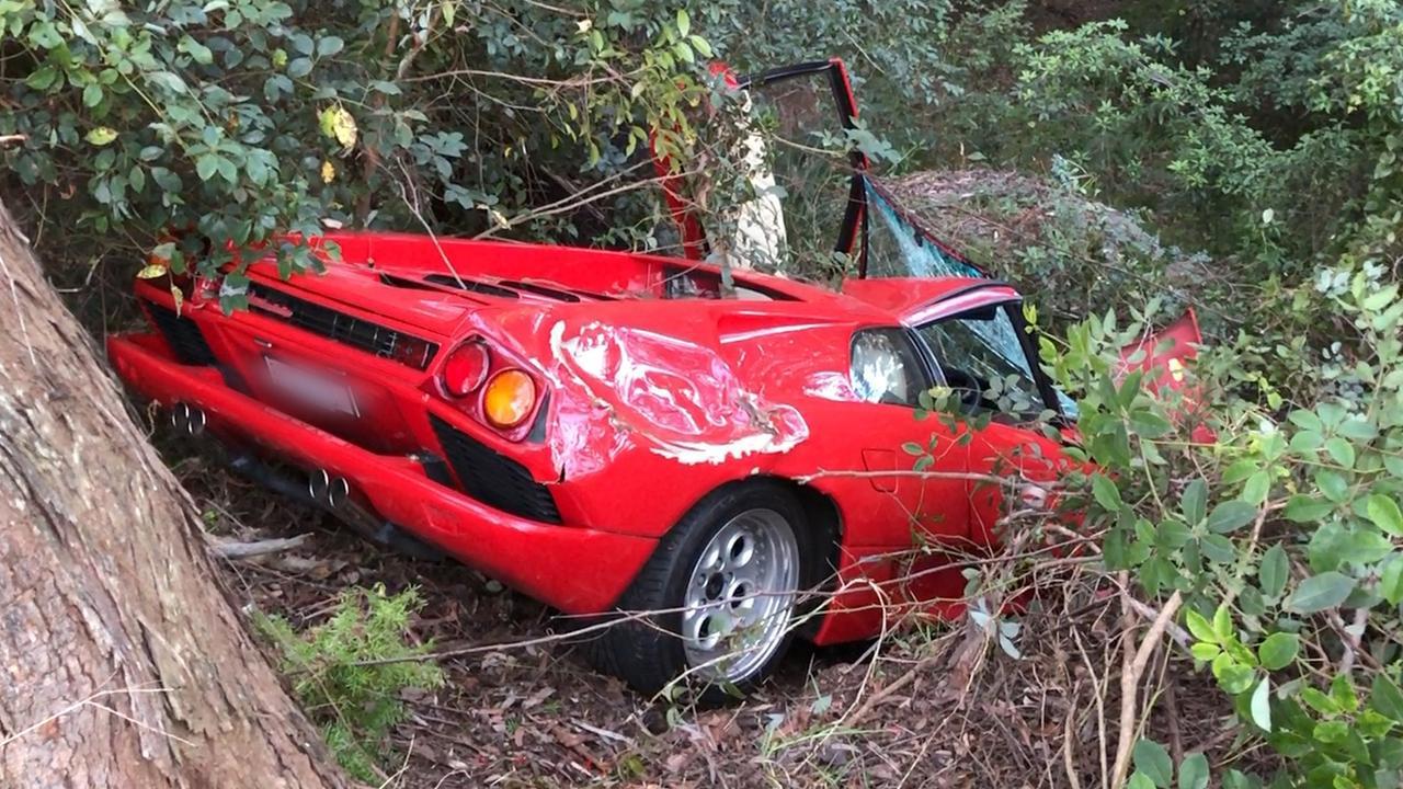 The Lamborghini Diablo crashed five metres down an embankment. Picture Michael Akkari.