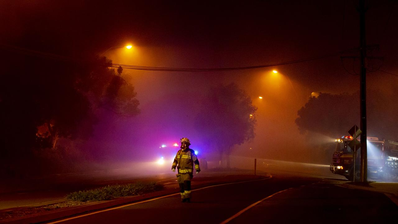 Fire and Rescue teams fight a wild bushfire as it approaches Peregian Beach township on David Low Way. Picture: Lachie Millard