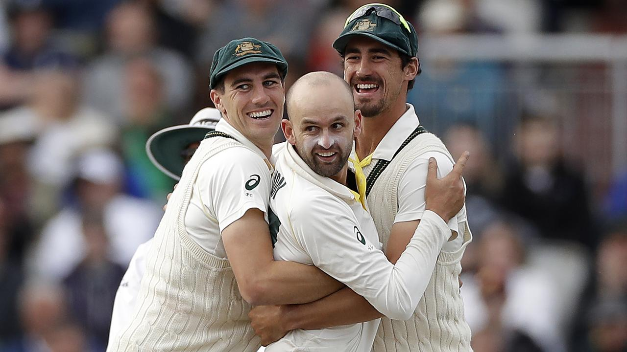 Nathan Lyon, Pat Cummins and Mitchell Starc celebrate a wicket for Australia. Picture: Getty Images