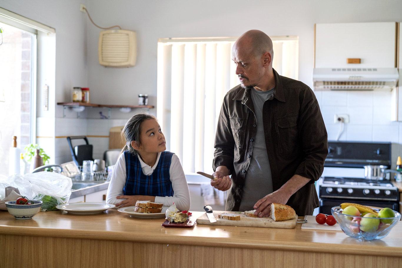 Chika Yasumura and Scott Ryan in a scene from season two of Mr Inbetween.