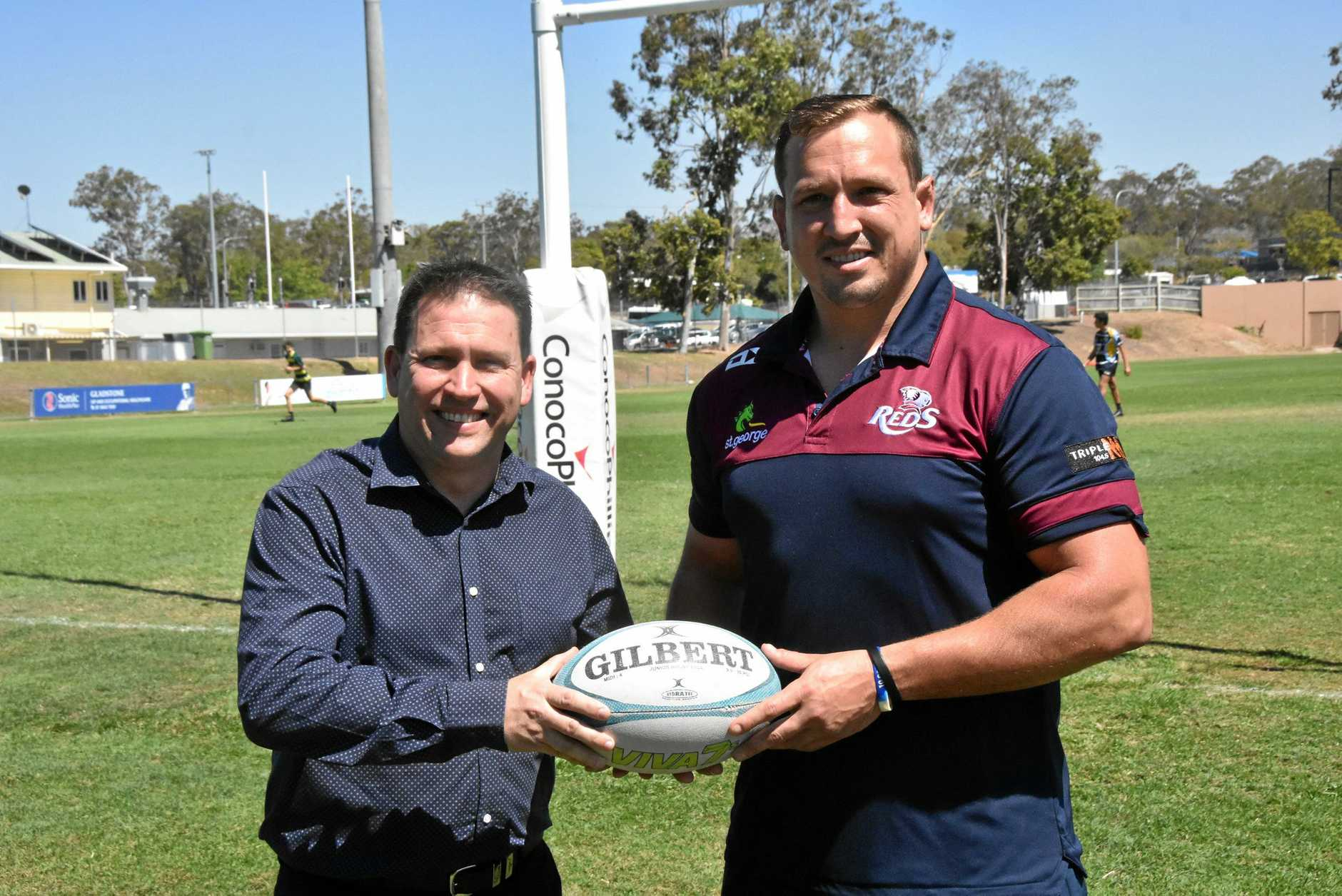 MAIN GAME: Gladstone mayor Matt Burnett with Queensland Reds player JP Smith at Marley Brown Oval ahead of the National Rugby Championship match between Queensland Country and Brisbane City on September 28.