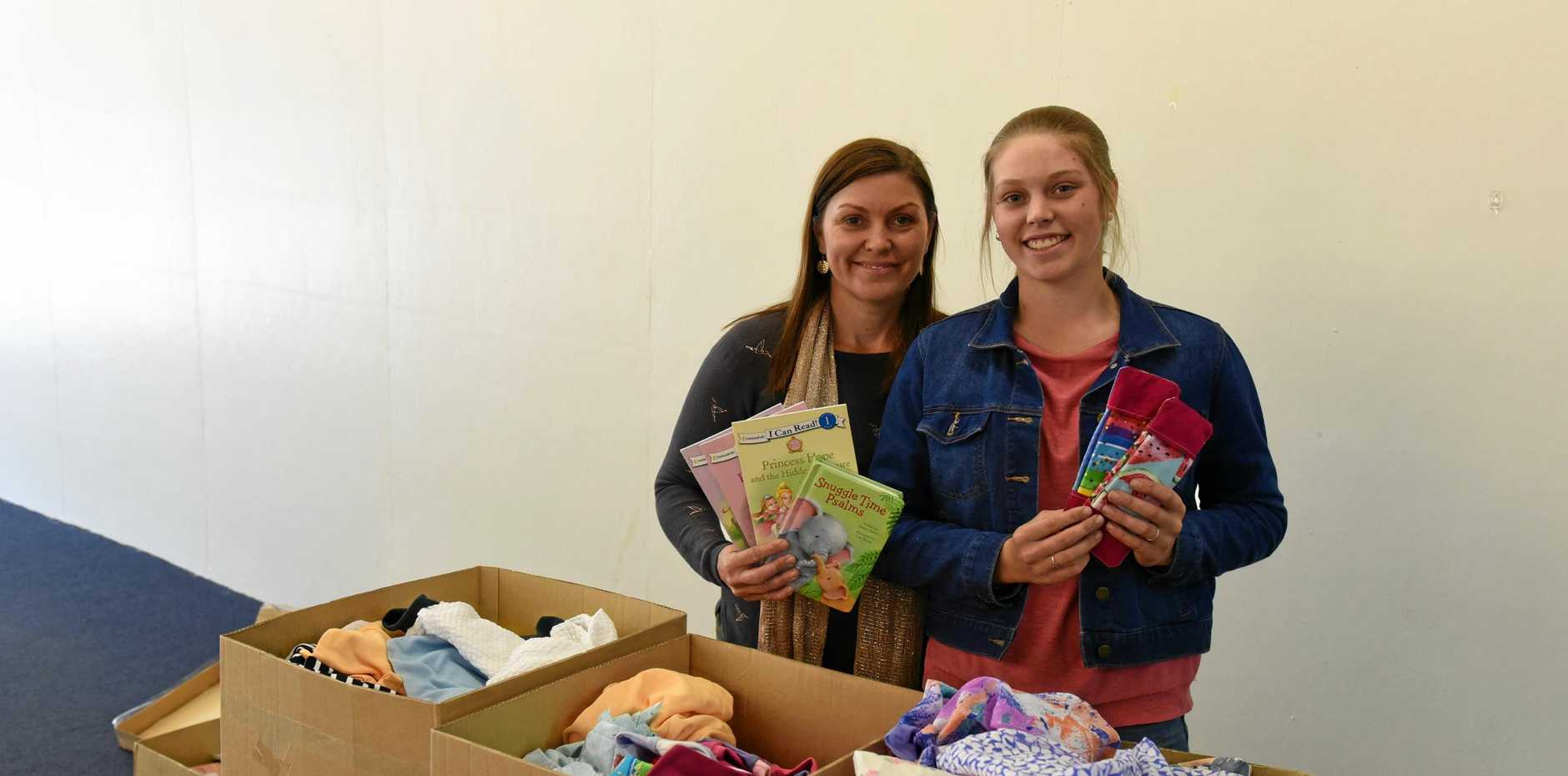 HUMANITARIAN: Ainsley and Miriam Shepherd with some of the items they have bought for African children with proceeds from the student's cooking.
