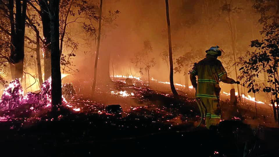 Firefighters have been working overnight at the scene of an out-of-control bushfire at Terragon, near Uki.