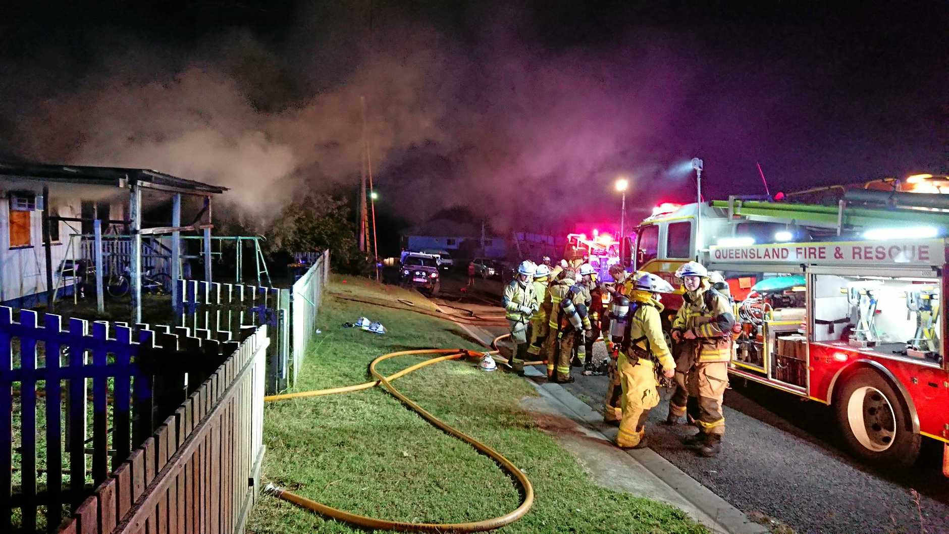 CHERBOURG FIRE: Fire fighters put out the blaze that engulfed the Oak Ave house.