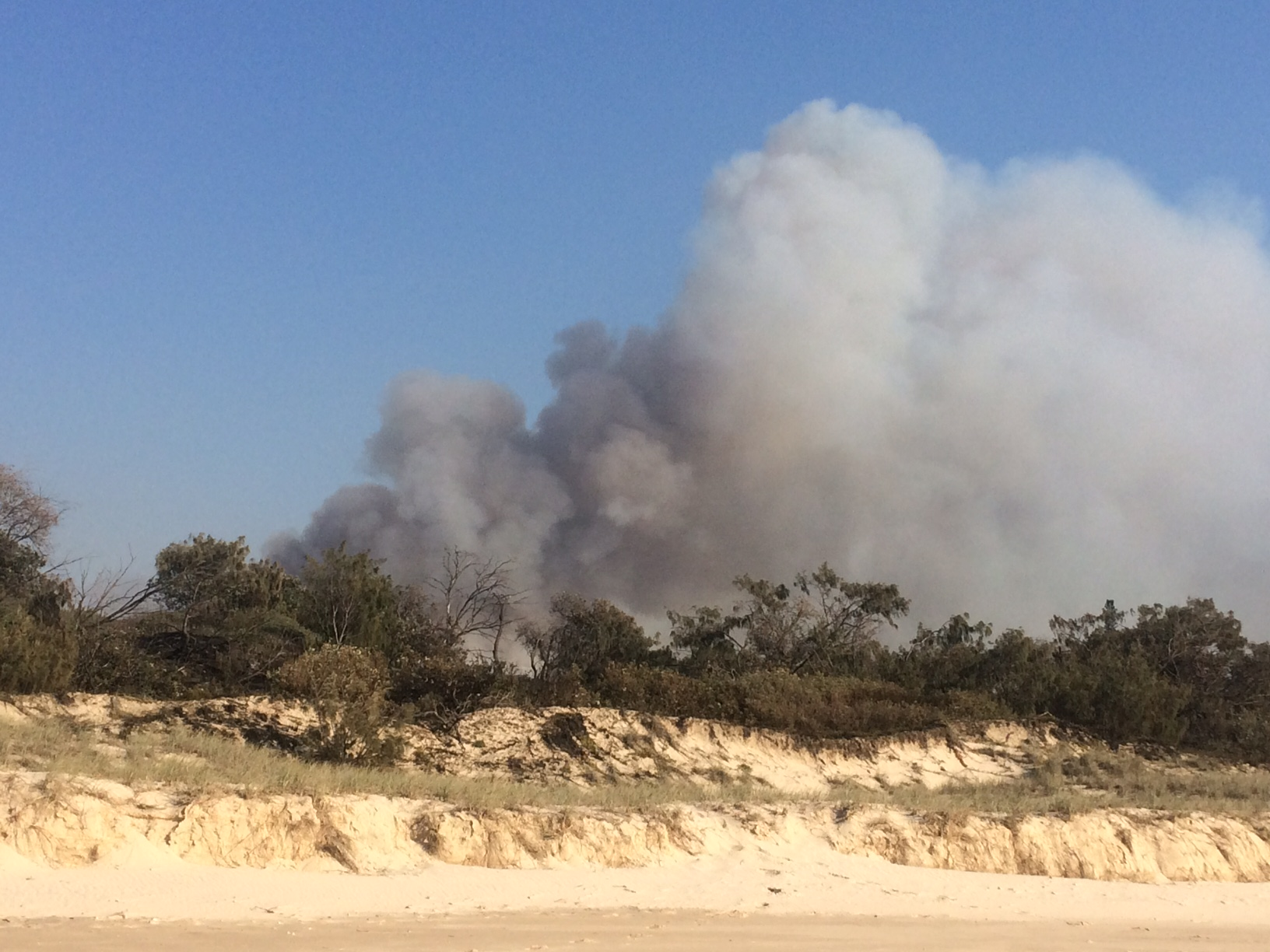 A critical hour is upon firefighting crews working to contain a major bushfire in the Sunshine Coast's north.