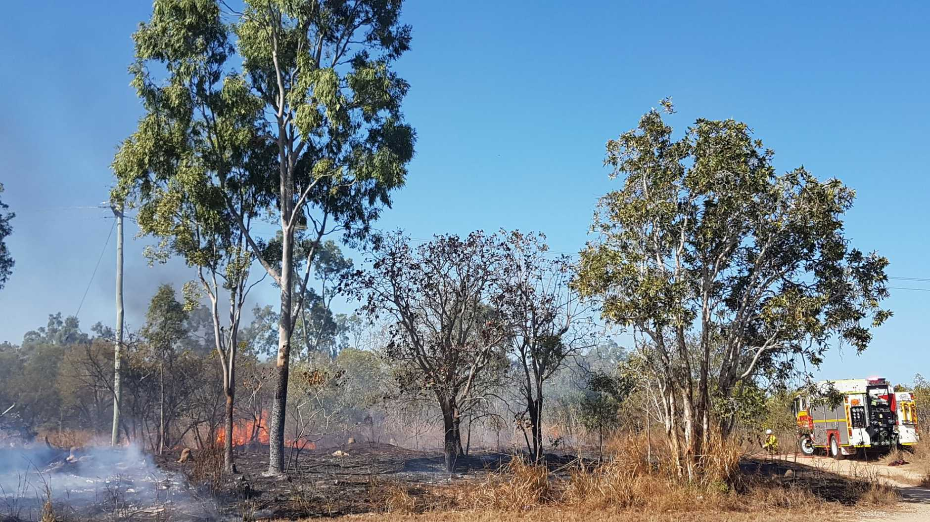 A bushfire seven kilometres south of Bowen has closed one lane of traffic on the Bruce Highway.