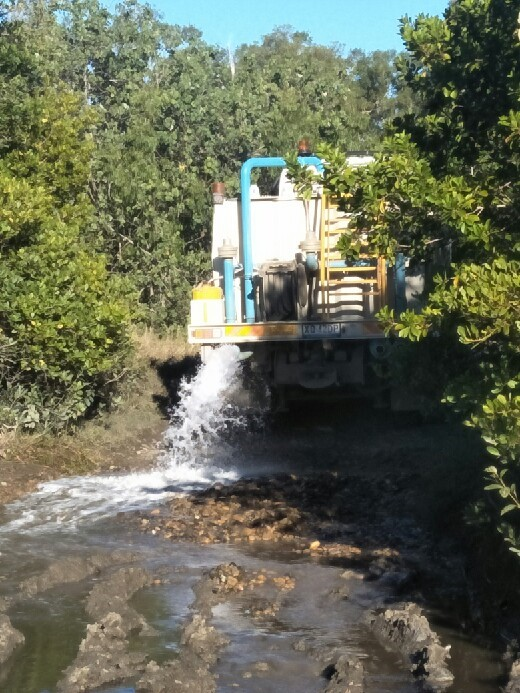 A still image taken from a video captured by concerned Mackay residents who happened upon a torrent of liquid along the coast and tracked it back to a water truck. The council has confirmed the liquid is environmentally safe.