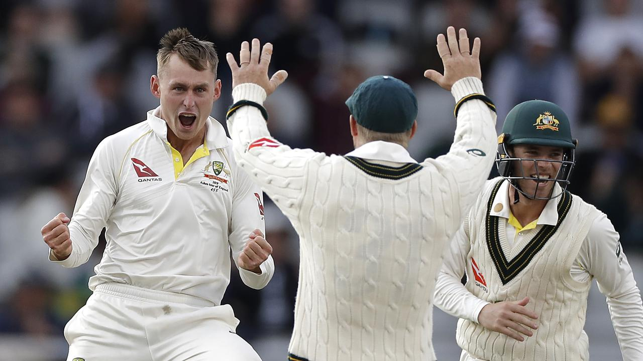 Marnus Labuschagne repaid Tim Paine's faith in his bowling by claiming the wicket of Jack Leach on the final day at Old Trafford. Picture: Getty Images