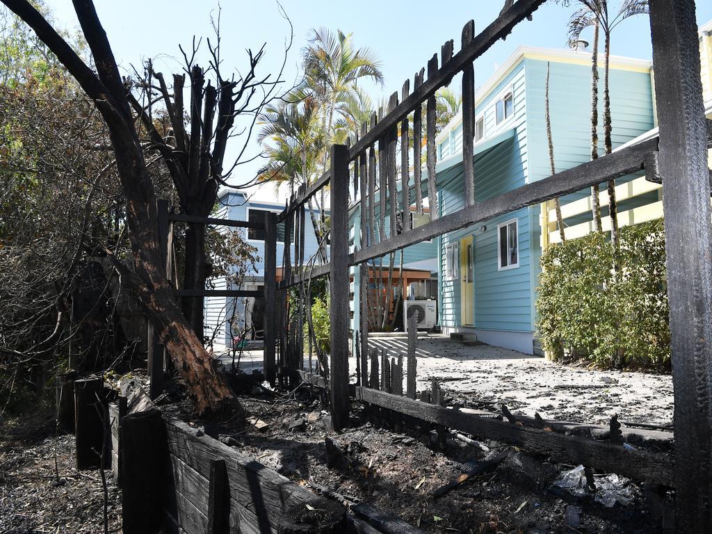 A charred fence. Photo Patrick Woods / Sunshine Coast Daily.