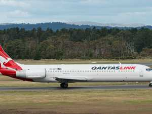 Police storm Qantas plane over fight
