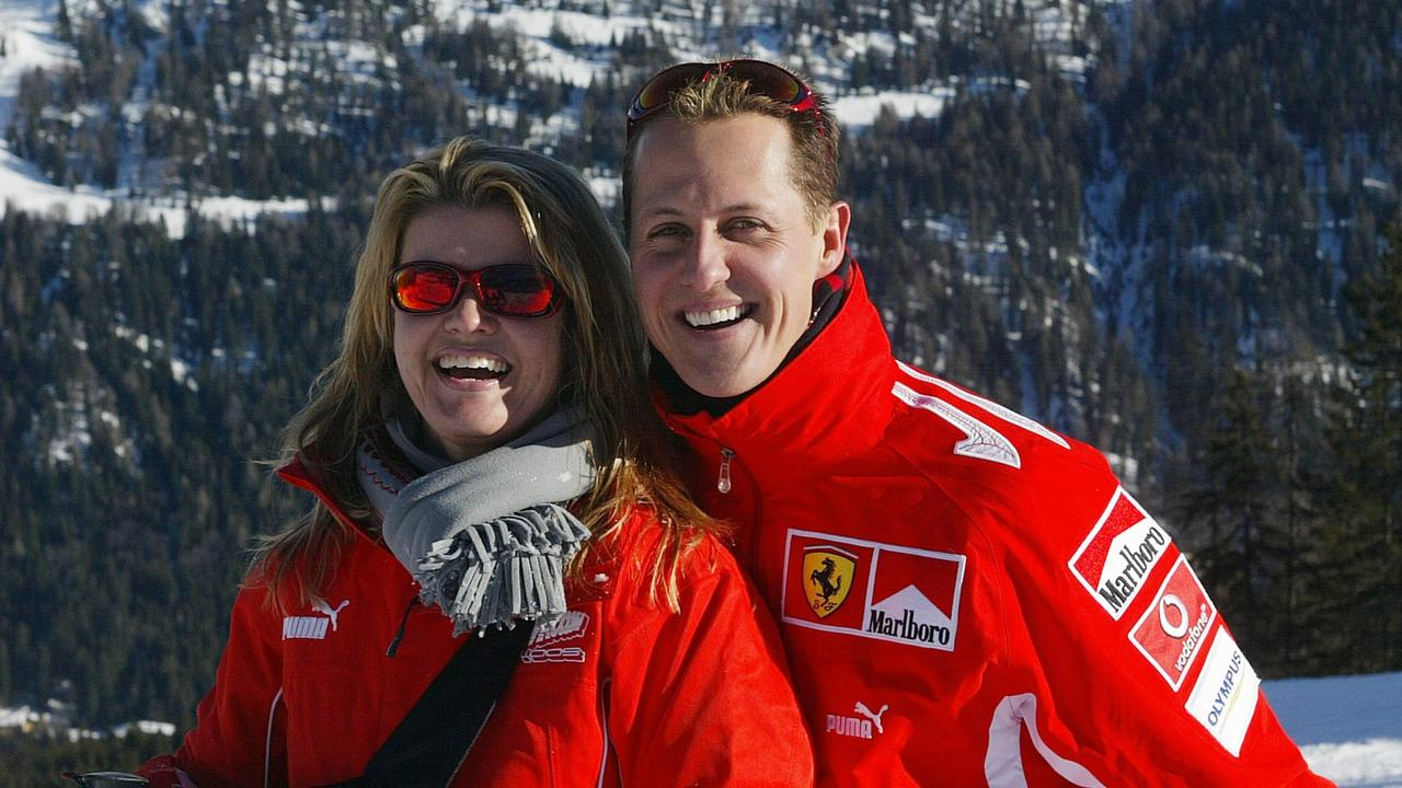 Michael Schumacher poses with his wife Corinna in 2005. AFP PHOTO