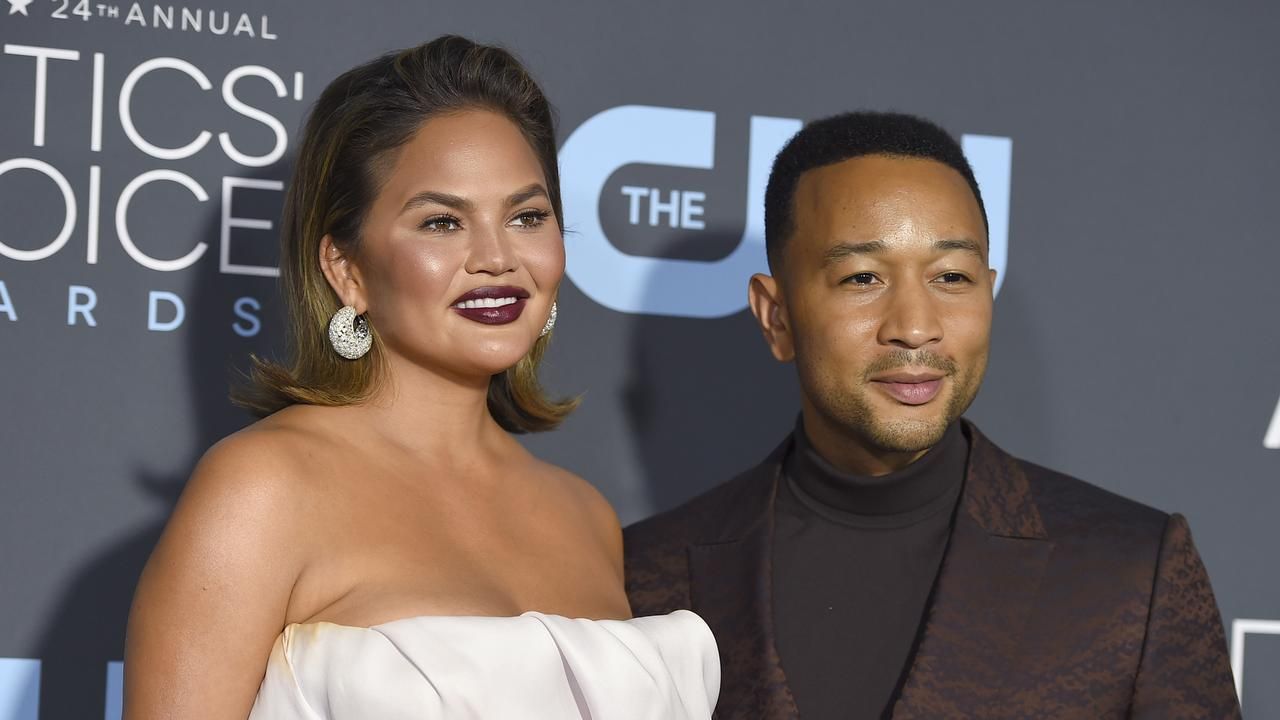 Chrissy Teigen, left, and John Legend arrive at the 24th annual Critics' Choice Awards at the Barker Hangar in Santa Monica, California in January 2019. Picture: Jordan Strauss/Invision/AP.