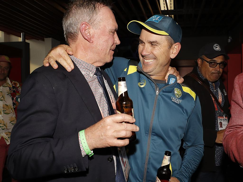 Australian coach Justin Langer (right) celebrates with chairman of selectors Trevor Hohns after Australia secured the Ashes in Manchester. Picture: Getty Images