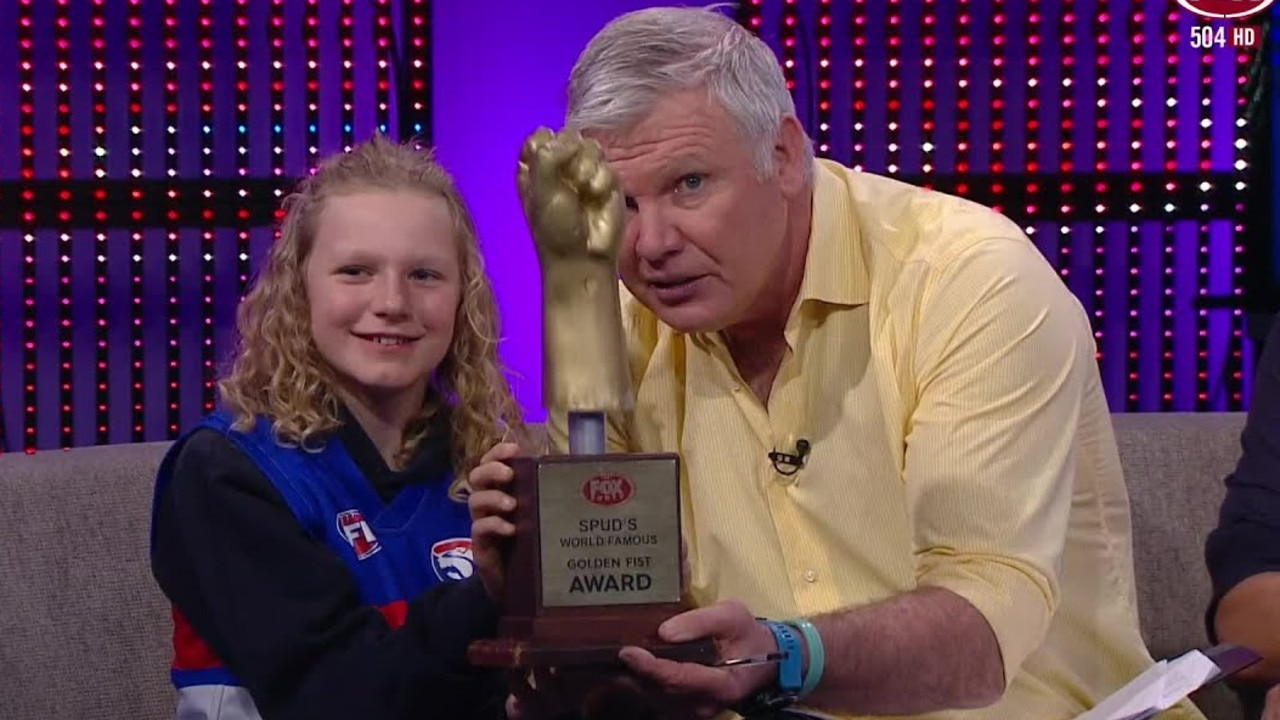 Danny Frawley and a fan giving out the Golden Fist Award for the week on Bounce.