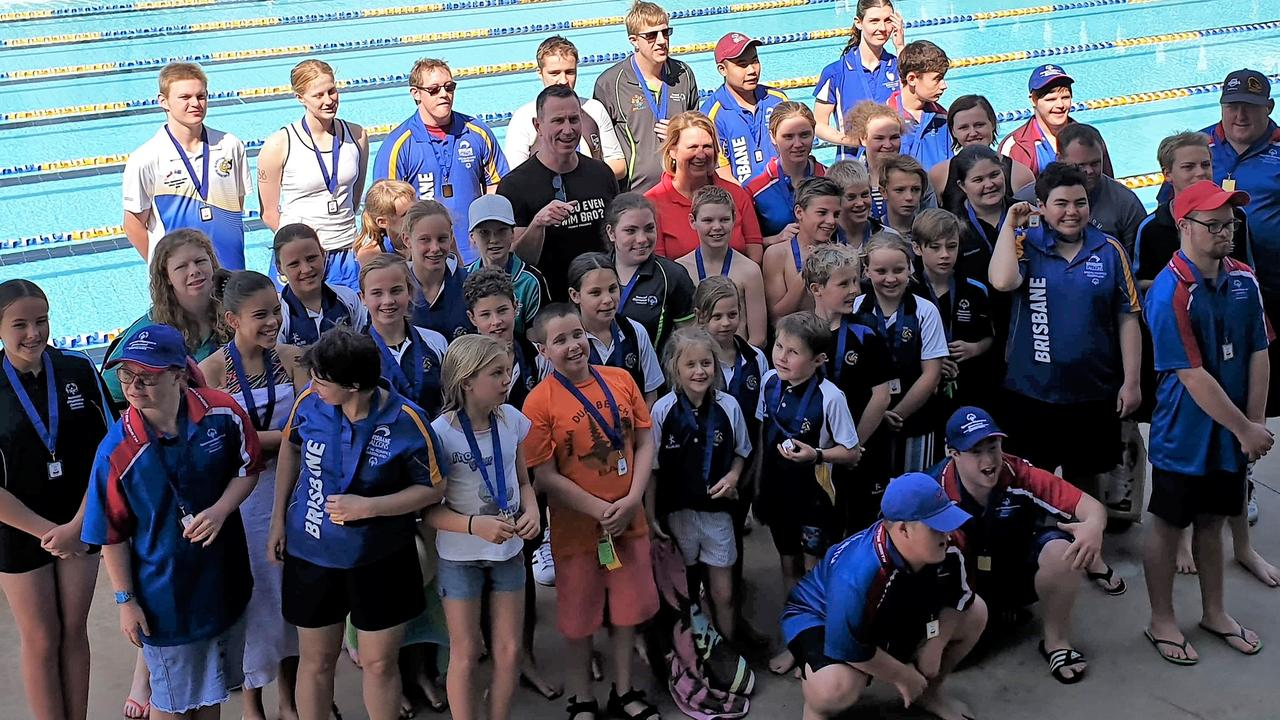 Gladstone Gladiators and Special Olympic swim clubs swim together in a regional first Unified Swim Meet.