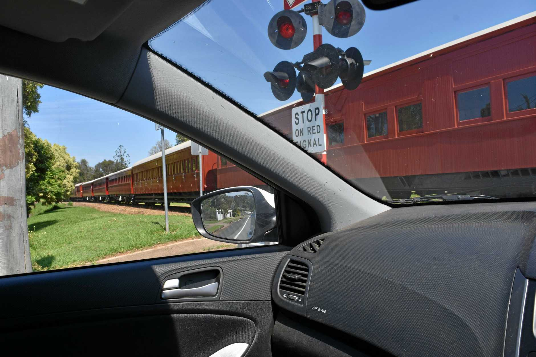 RATTLER: Drivers need to remember the Rattler is back on the rails in Gympie, including on the level crossings where motorists now need to keep an eye out for the flashing lights that say a train is on the way.