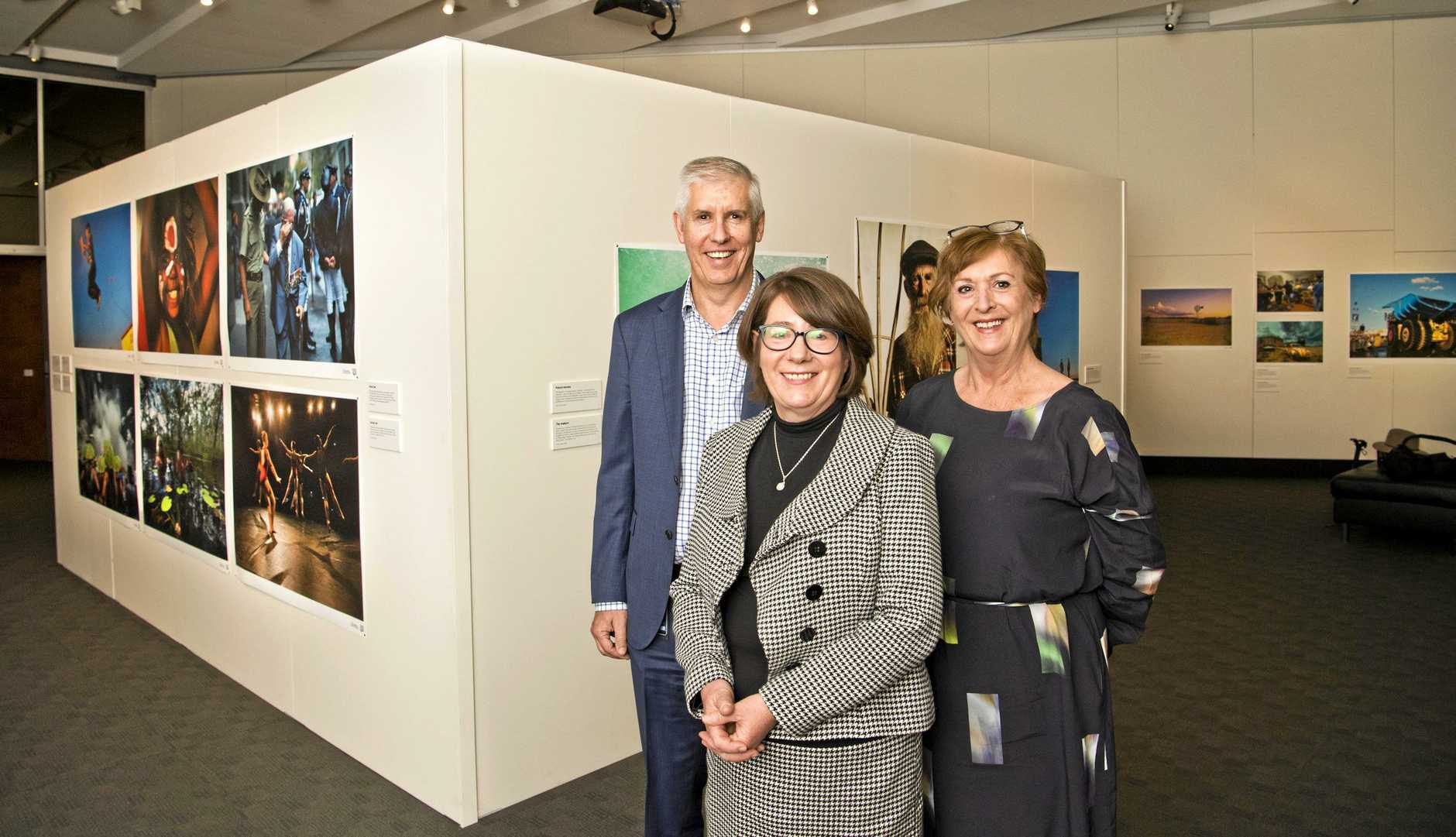STORIES: At the opening of A Portrait of Australia at Cobb and Co are (from left) Qld Museum CEO Jim Thompson, Australian Geographic editor Chrissie Goldrick and National Museum of Australia assistant director Ruth Wilson.