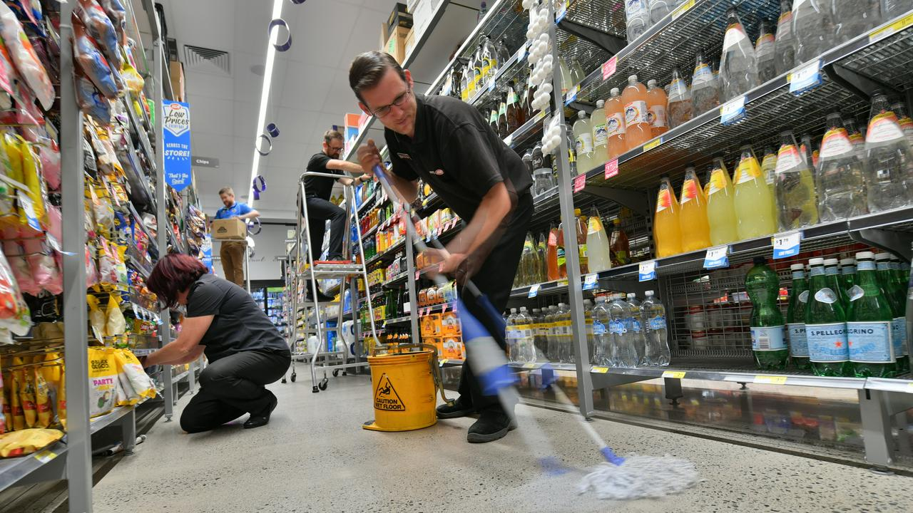Workers at the IGA in Peregian were hard at work making the place safe and ready for customers. Leanne Blyde, Matt Cooper, Will Hendey and Anthony Baldwin in action. Photo: John McCutcheon / Sunshine Coast Daily
